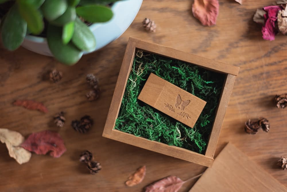wooden usb box filled with moss